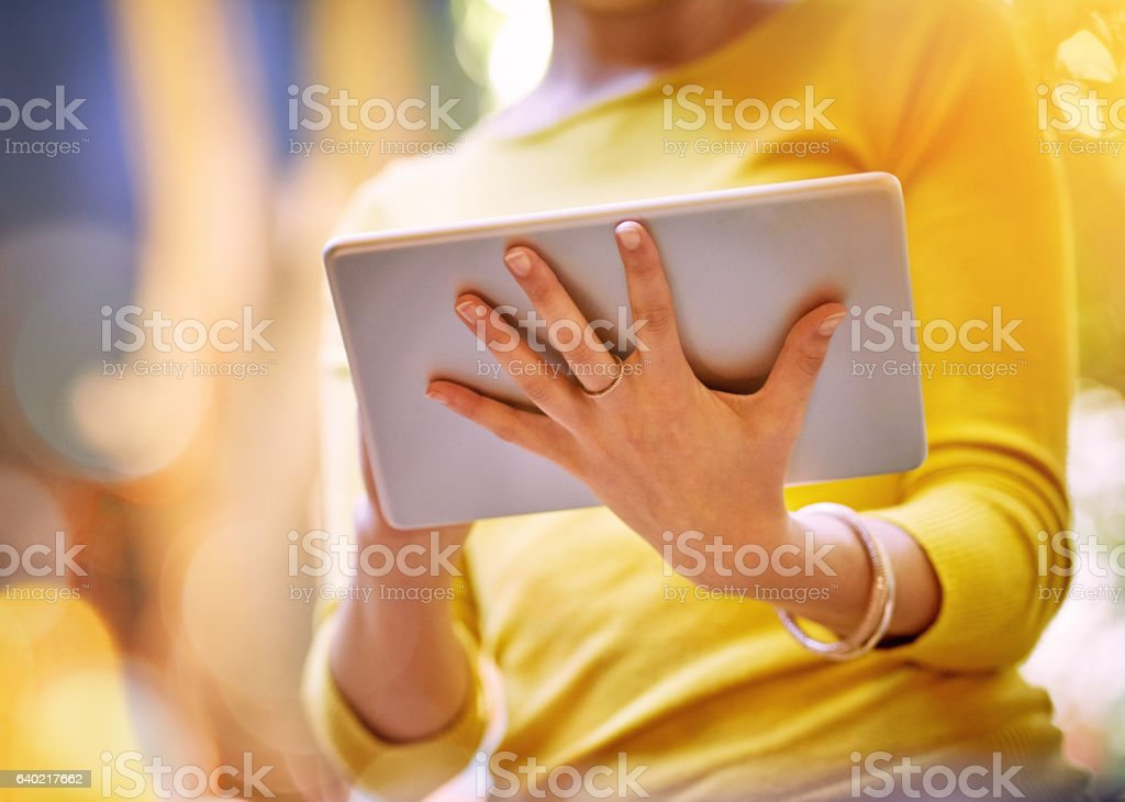 Her wireless device of choice stock photo