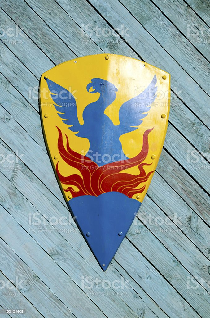 heraldic shield on wooden background royalty-free stock photo