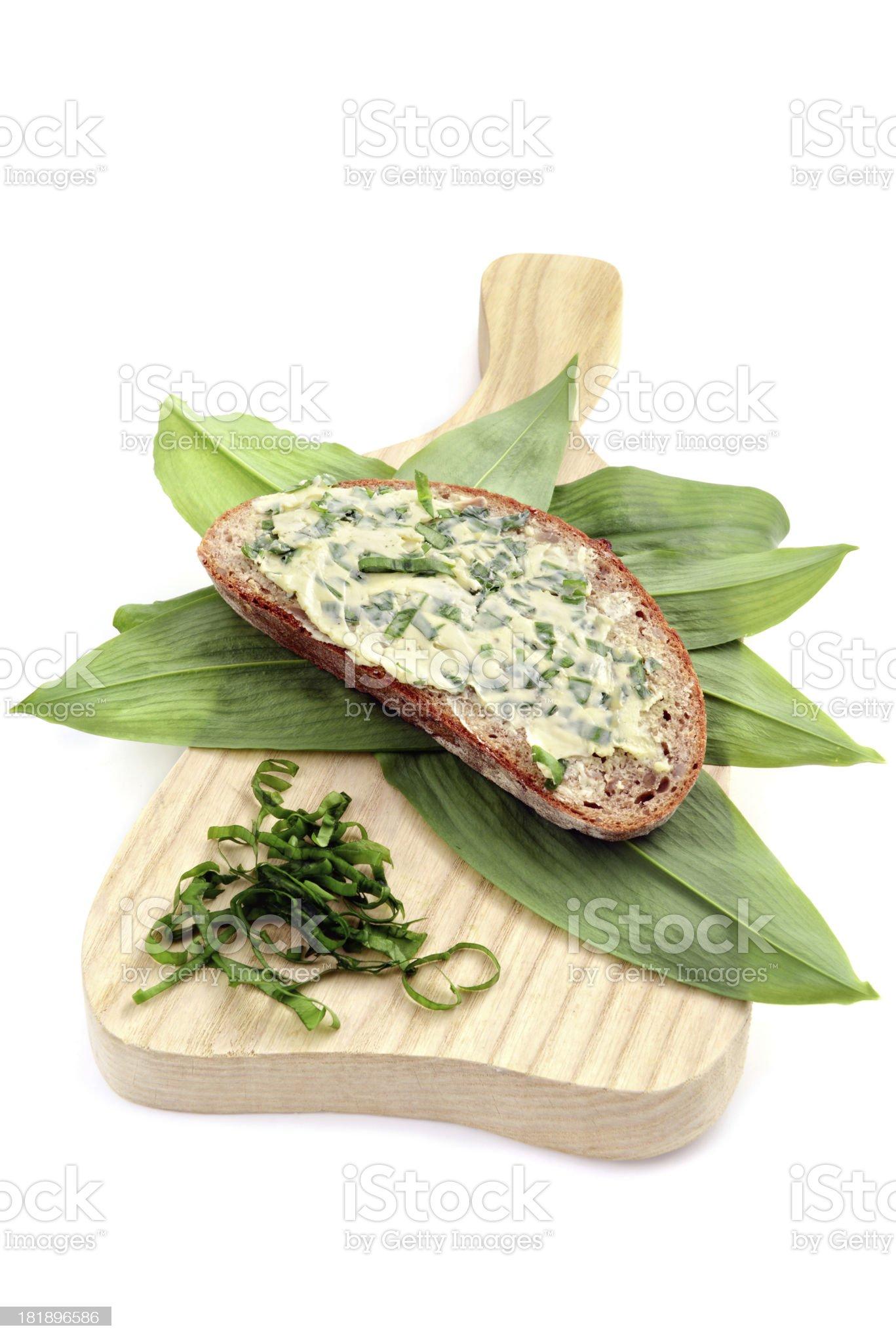herb butter wild garlic (Allium ursinum) on slice of bread royalty-free stock photo