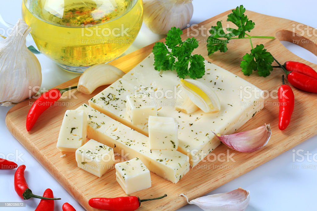 Herb cheese with garlic, chillies and oil stock photo