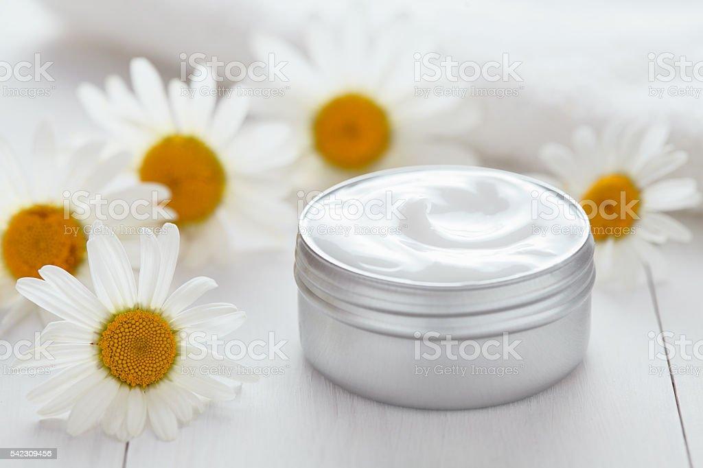 Herb cosmetic anti wrinkle cream chamomile vitamin spa organic moisturizer stock photo