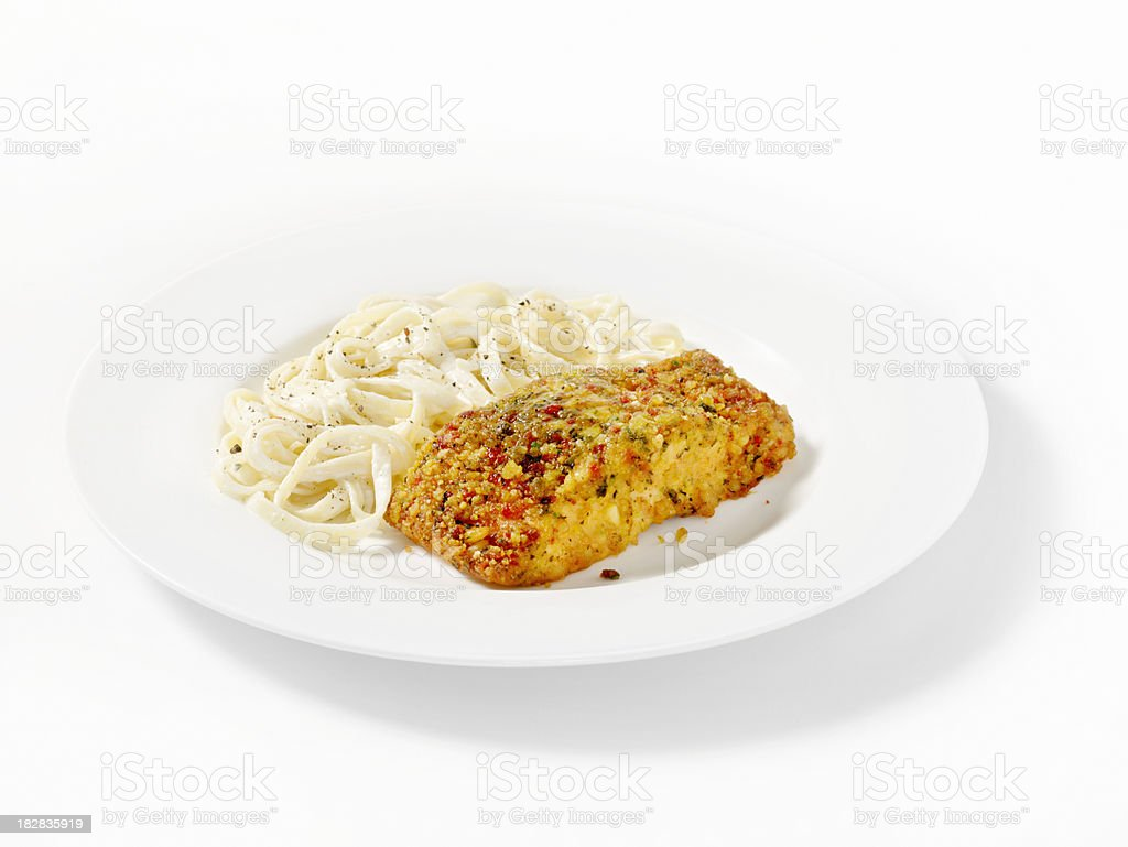 Herb Crusted Baked Salmon Fillet with Fettucine Alfredo royalty-free stock photo