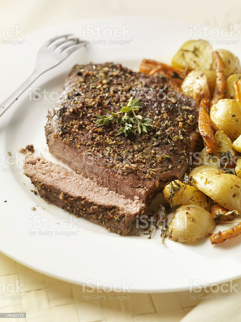 Herb Crusted Steak with Potatoes and Carrots royalty-free stock photo