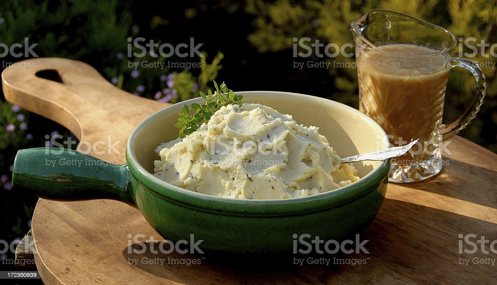 Herb Mashed Potatoes & Turkey Gravy, Thanksgiving Dinner Food, Root Vegetable royalty-free stock photo