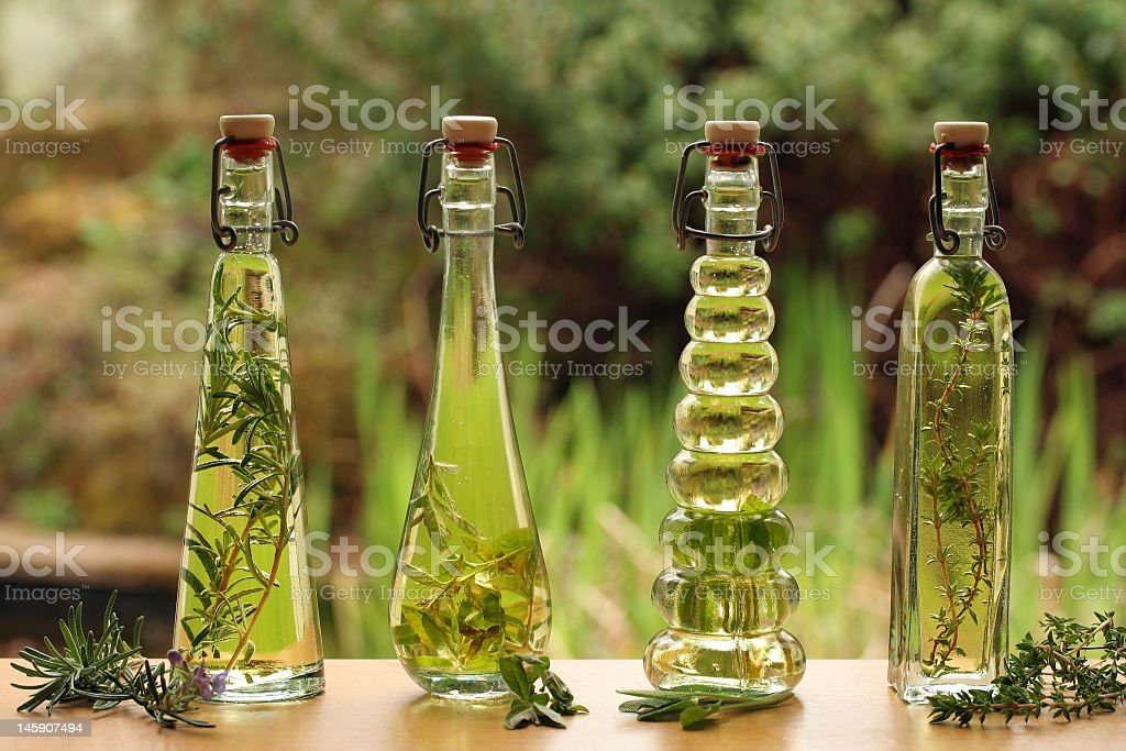 herb oils in bottles stock photo