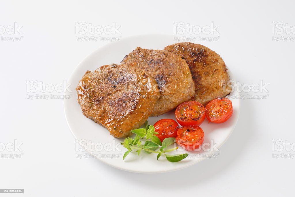 herb rubbed pork chops stock photo