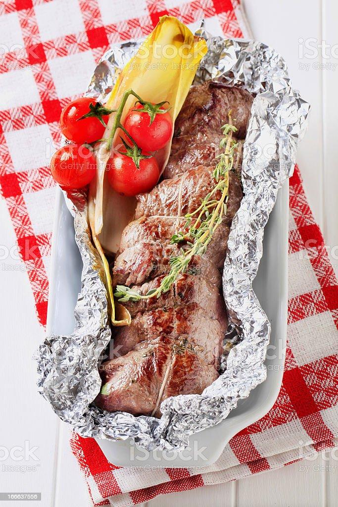 Herb stuffed beef tenderloin royalty-free stock photo