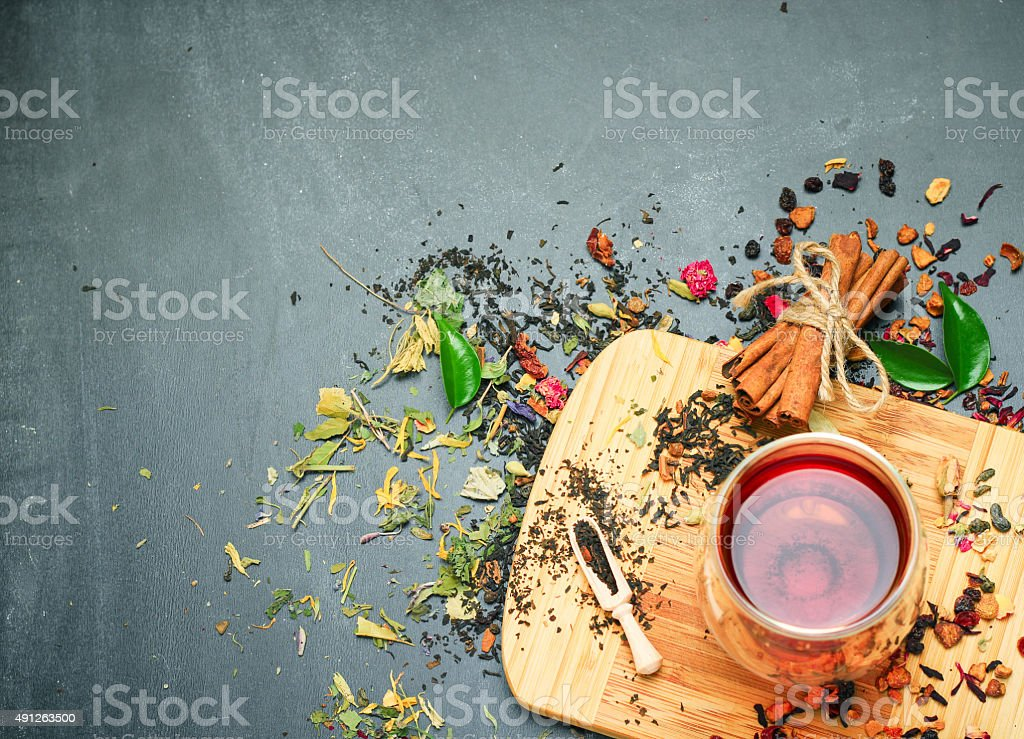 Herbal and masala tea on a black chalkboard stock photo