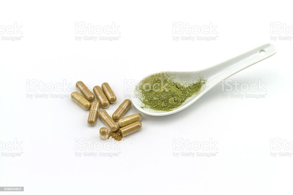 Herbal capsule and powder  on white  background. stock photo