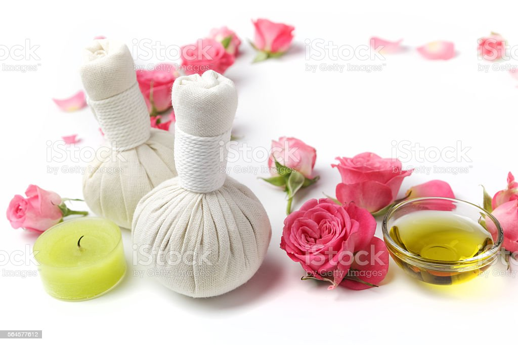 Herbal compress balls for spa treatment with rose flower stock photo