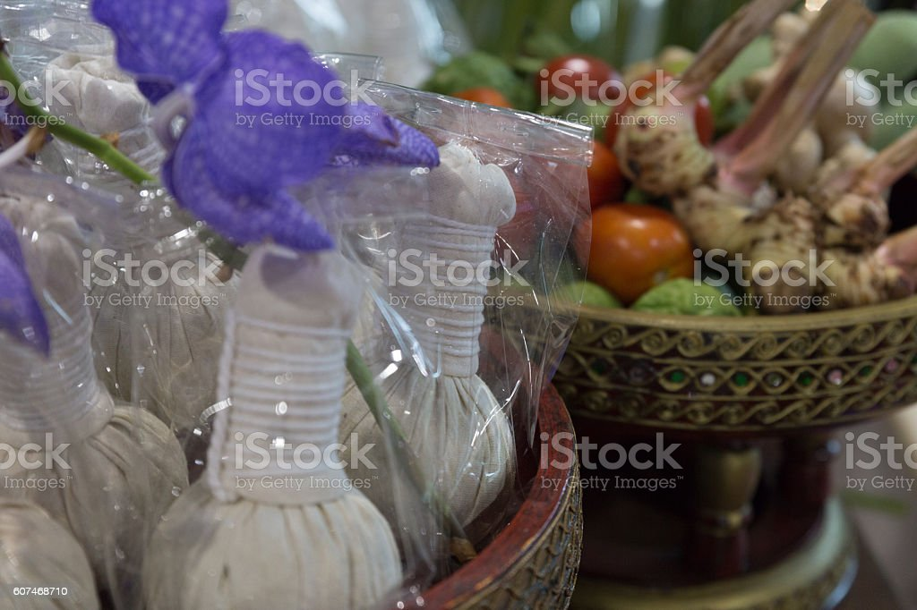 herbal compress massage ball in spa stock photo