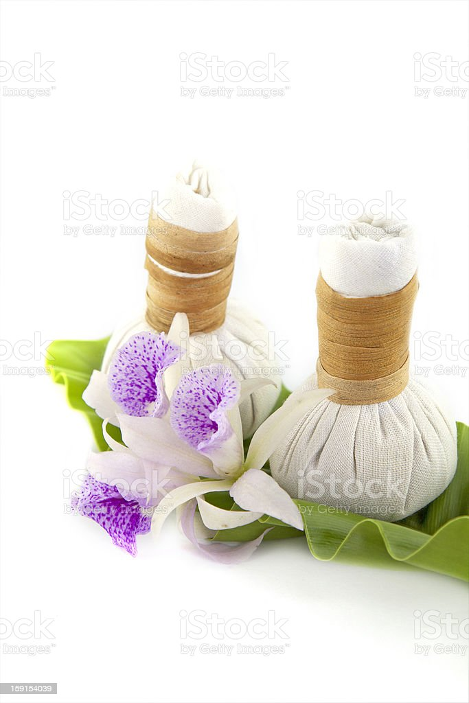 herbal compress with orchid flower stock photo