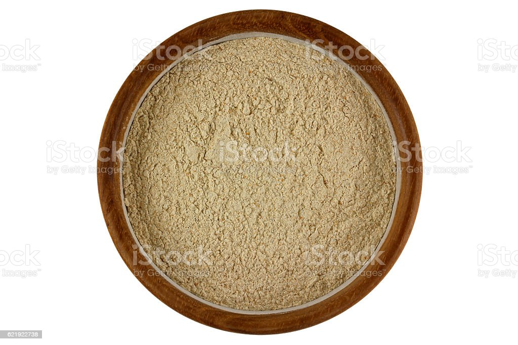 Herbal facial scrub in light brown in wooden bowl stock photo