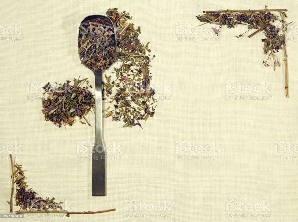 Herbal flat lay of different herbs on linen fabric with a spoon stock photo
