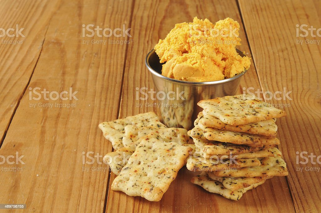 Herbal flatbread crackers with cheese spread royalty-free stock photo