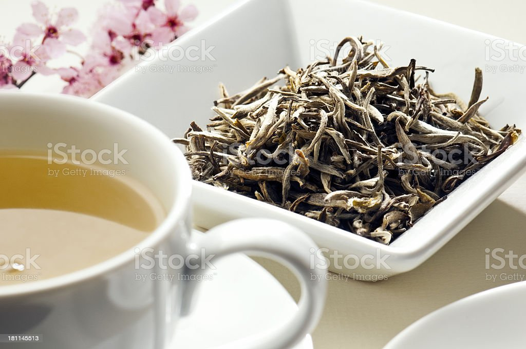 Herbal jasmine green tea leaves and cup of tea stock photo