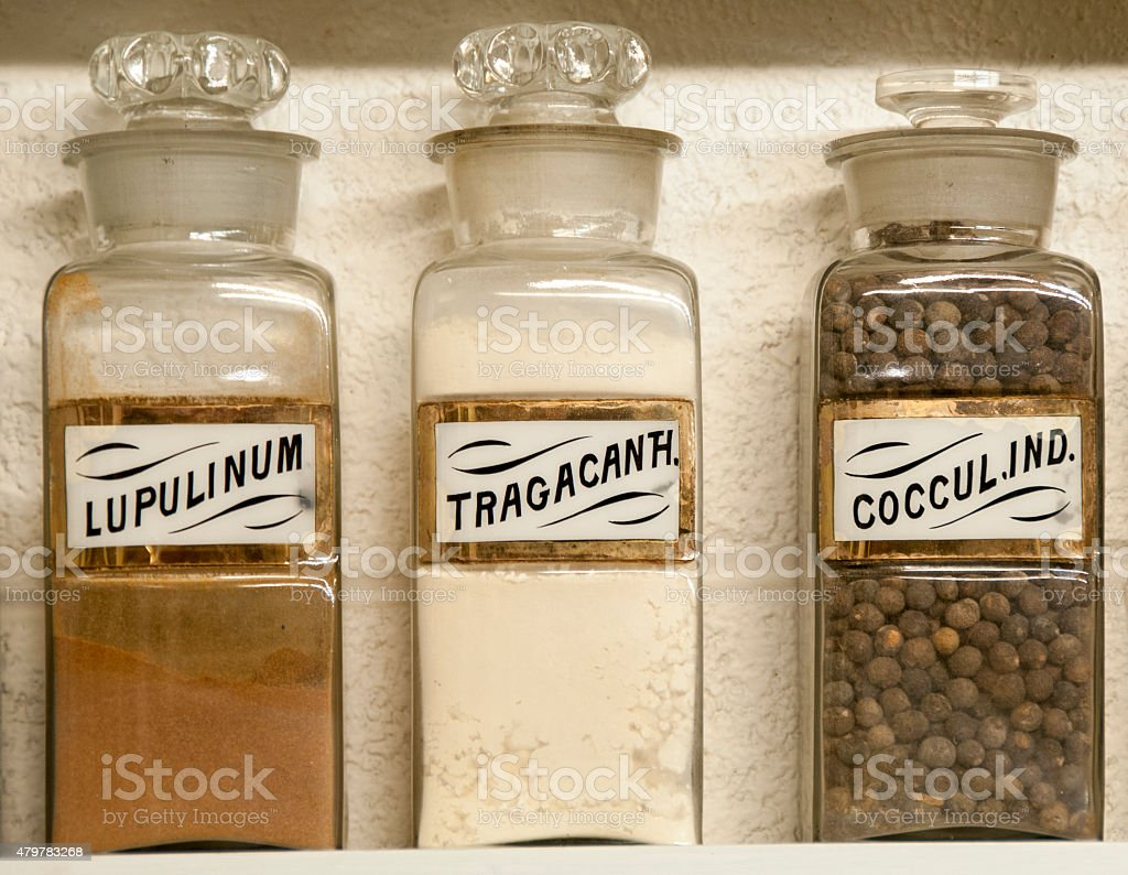herbal medicines in antique apothecary or pharmacy jars stock photo