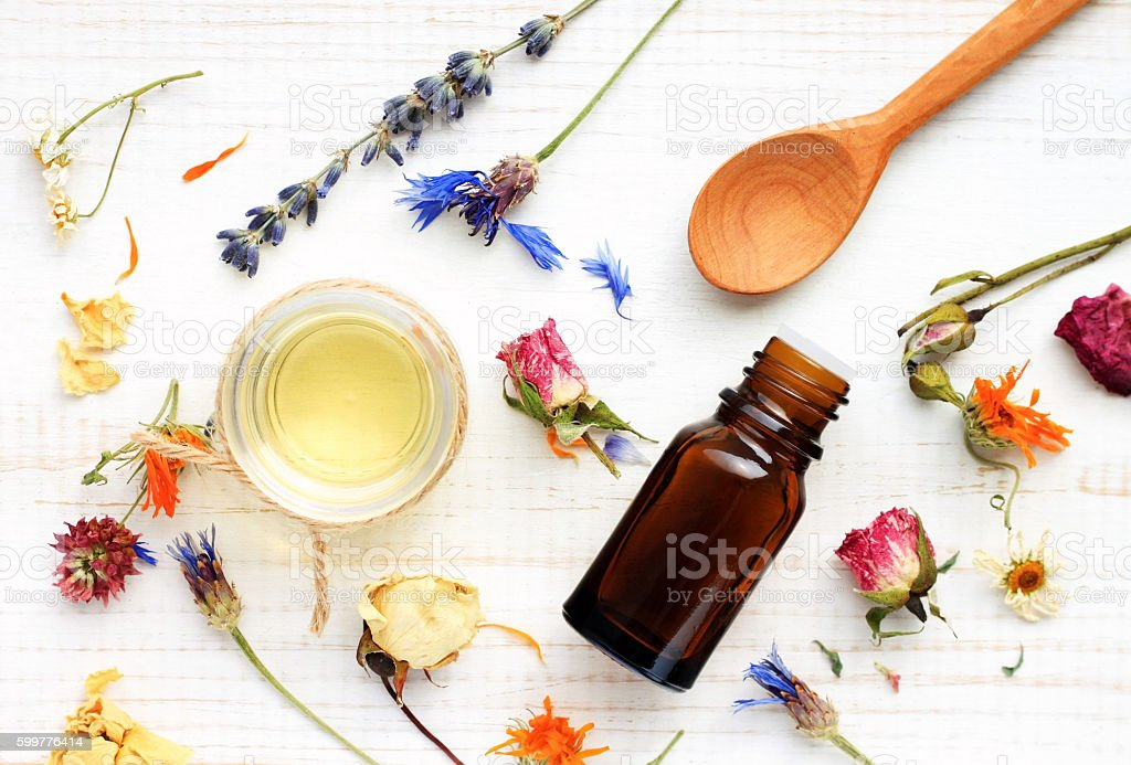 Herbal skincare.Oil,extract,aroma,dried flowers stock photo