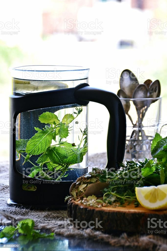 Herbal tea drink. Thyme and mint tea stock photo