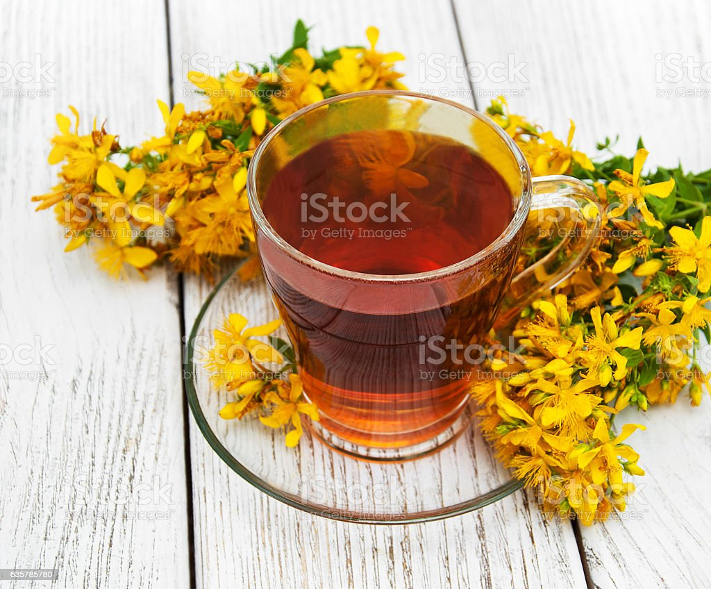 herbal tea in a glass cup stock photo