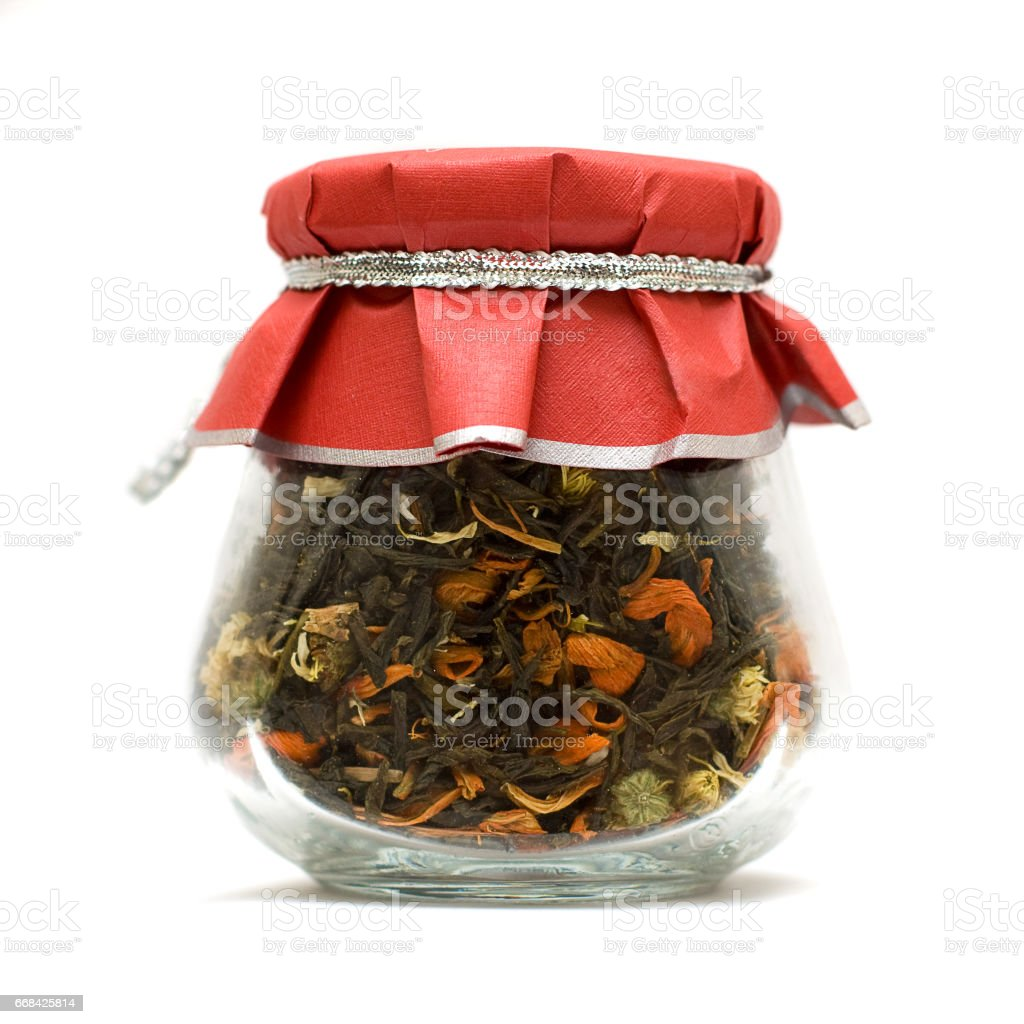 Herbal tea in glass jar isolated over white stock photo