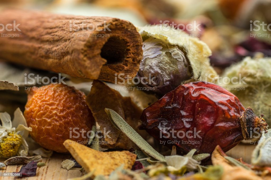 Herbal Tea Mixture Cinnamon, Jasmine, Rose hip, bud, lip balm stock photo