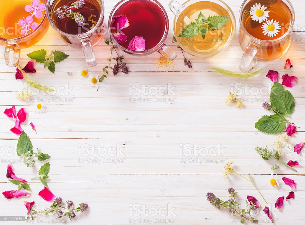 herbal tea on a white wooden background stock photo