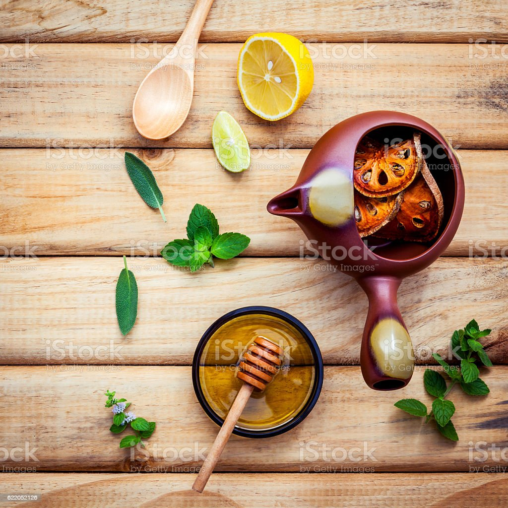 Herbal tea pot with fresh herbs sage ,peppermint ,dried indian stock photo