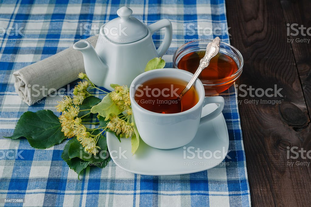 Herbal tea with flowers on blue napkin stock photo