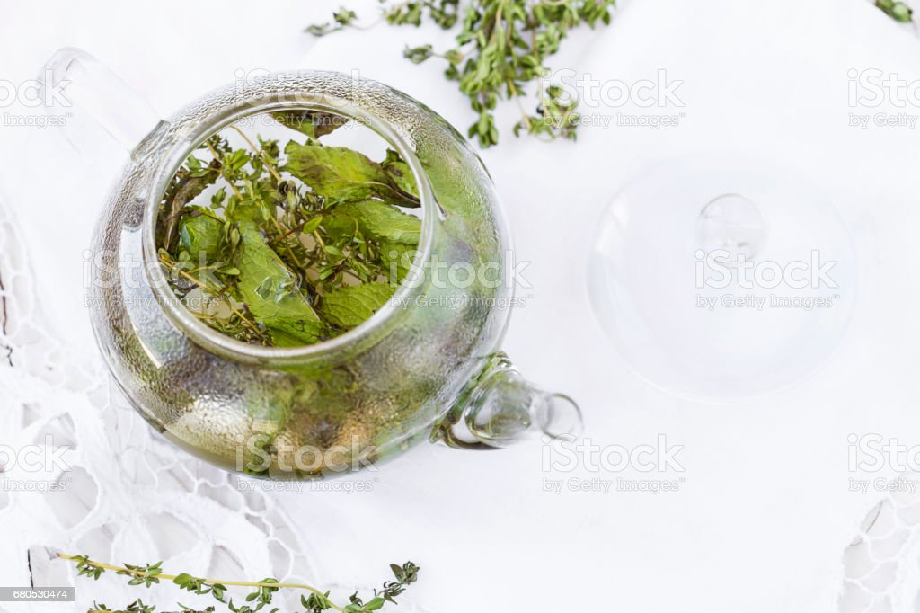 herbal tea with mint and thyme stock photo