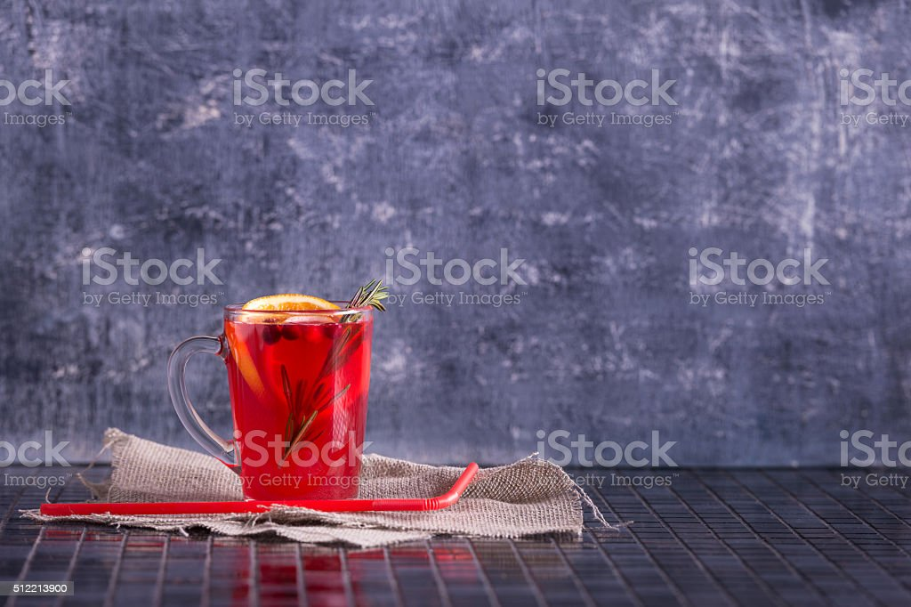 Herbal tea with rosemary and fruit and berries stock photo