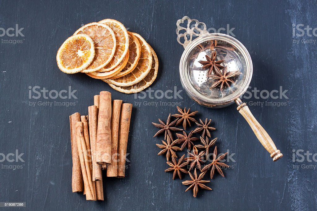 herbal tea with star anise, dried orange and cinnamon stock photo