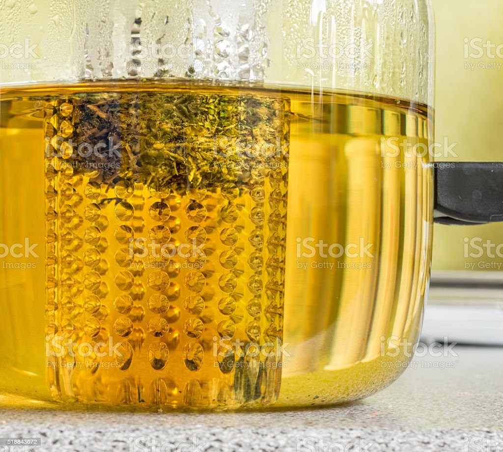 herbal tea with tea strainer in a teapot stock photo