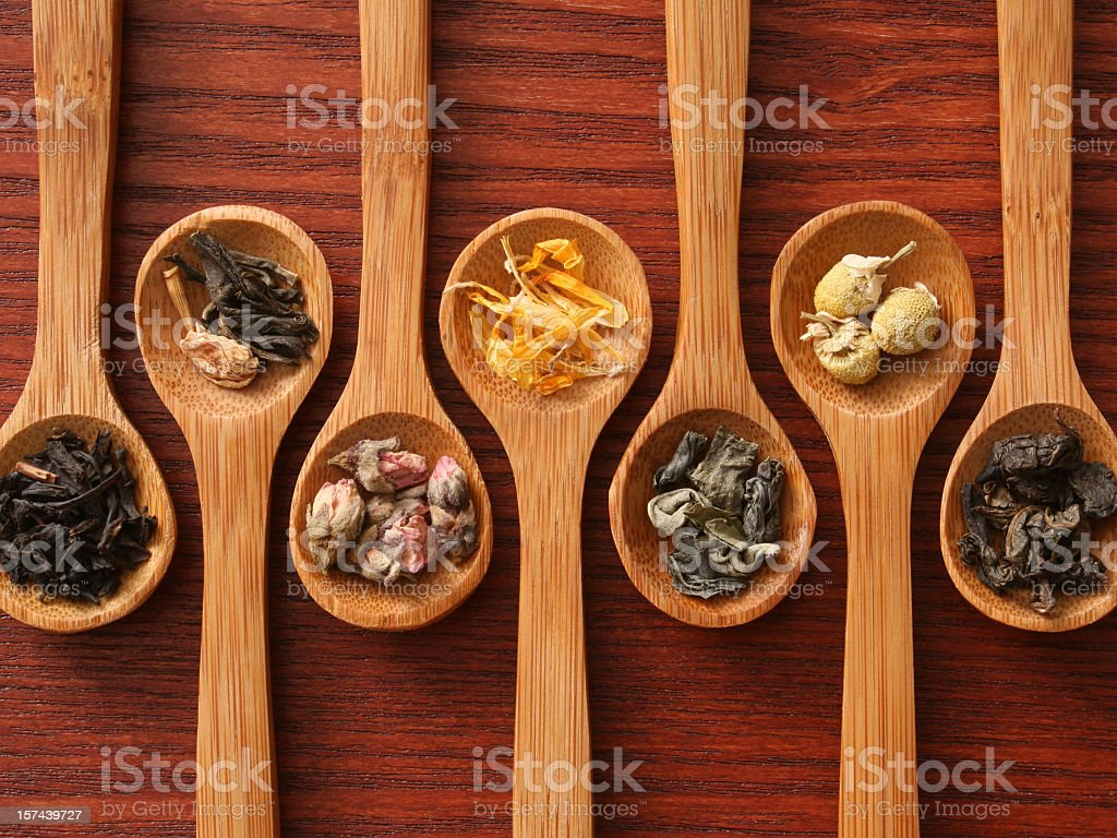 Herbal teas and spoons stock photo