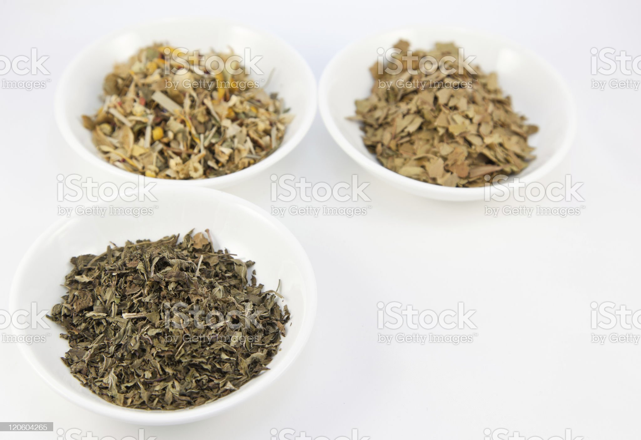 Herbal teas in small white bowls royalty-free stock photo