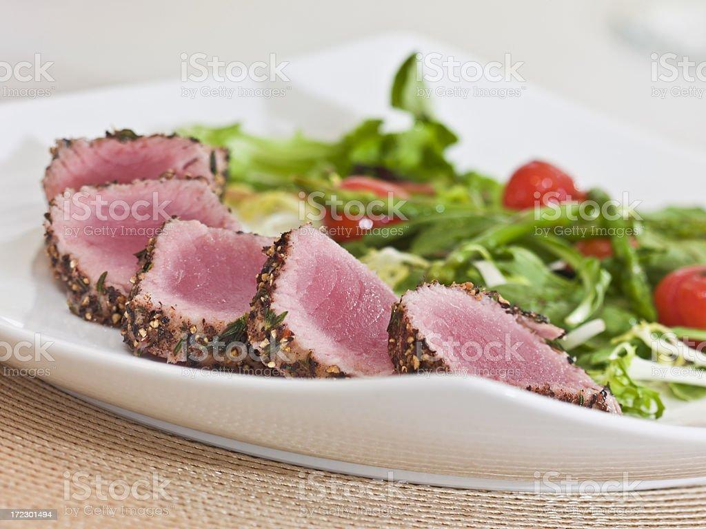 herb-crust tuna loin stock photo