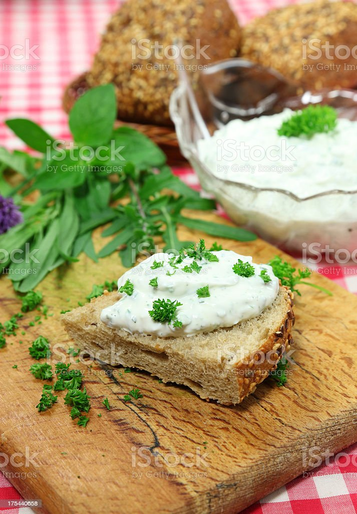 Herbed Curd cheese on a bun stock photo