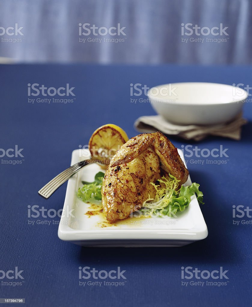 Herb-roasted chicken with lemon royalty-free stock photo