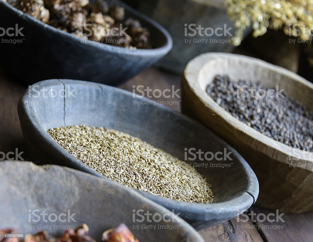 Herbs and spices in bowls stock photo