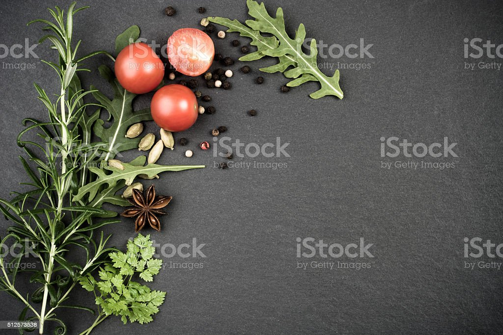Herbs and spices on dark background stock photo