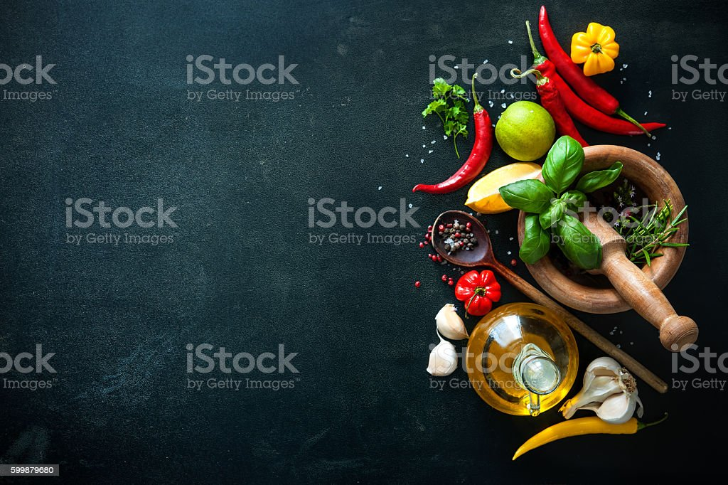 Herbs and spices on slate background royalty-free stock photo