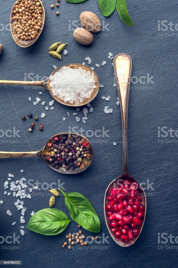 Herbs and spices on slate. stock photo