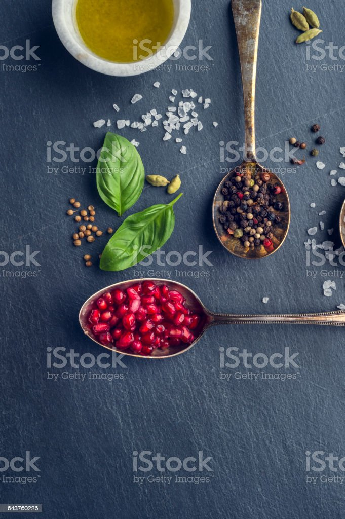 Herbs and spices on slate stock photo