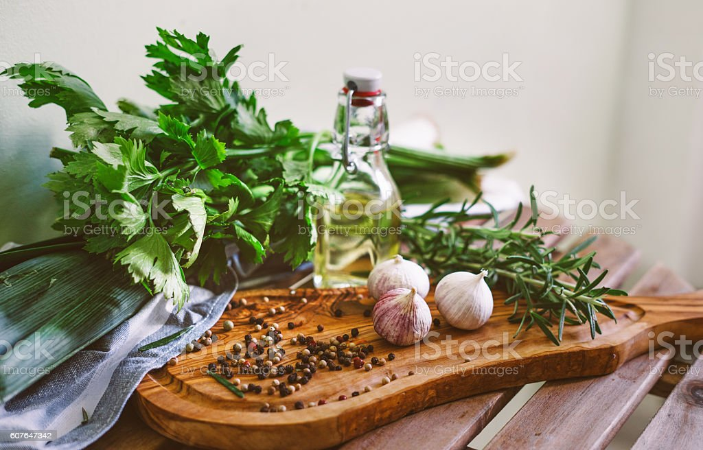 Herbs and spices on the kitchen table stock photo