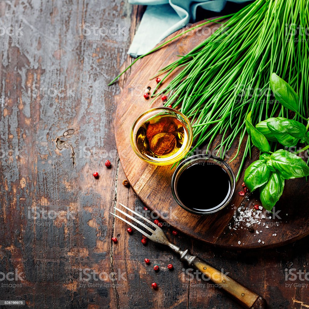 Herbs and spices on wooden board stock photo