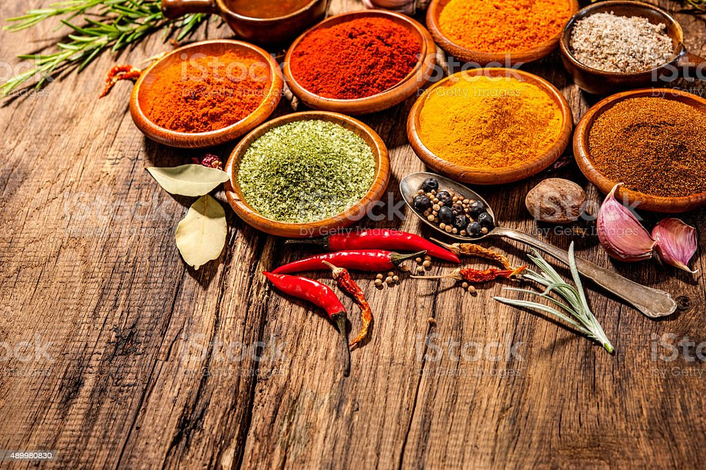 Herbs and spices on wooden table stock photo