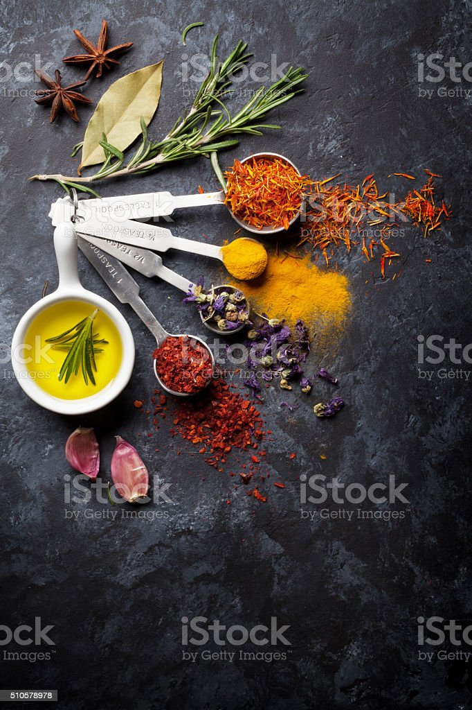 Herbs and spices over black stone stock photo