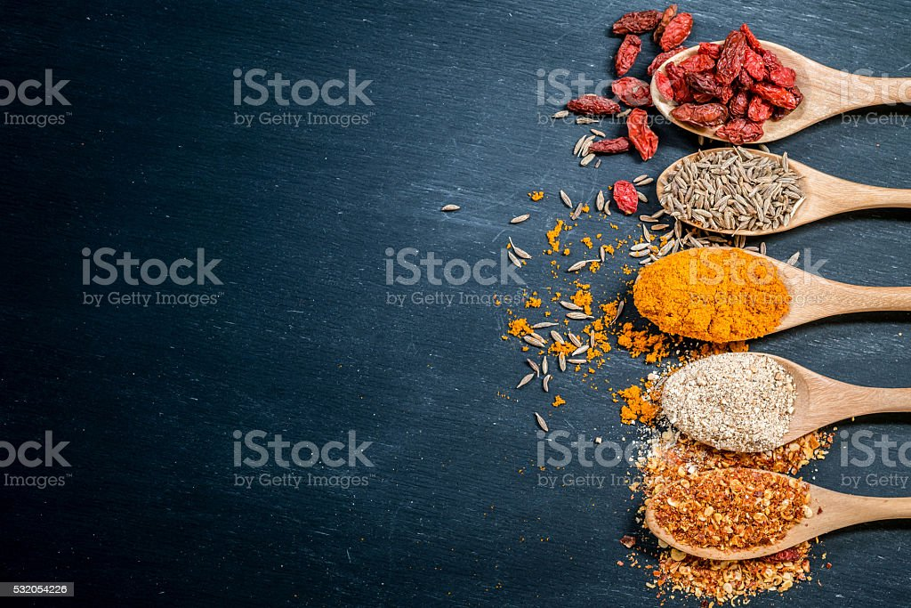 Herbs and spices over blackboard background. Top view with copy stock photo