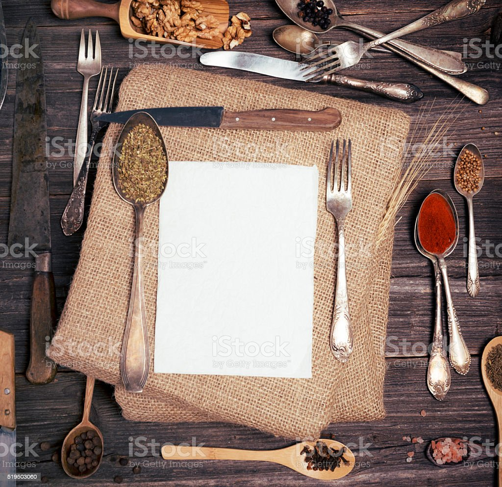 Herbs and spices over menu stock photo