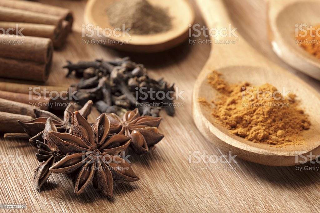 Herbs and Spices over wooden background royalty-free stock photo